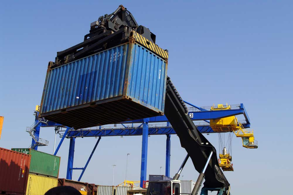 car being loaded onto an international ocean vessel