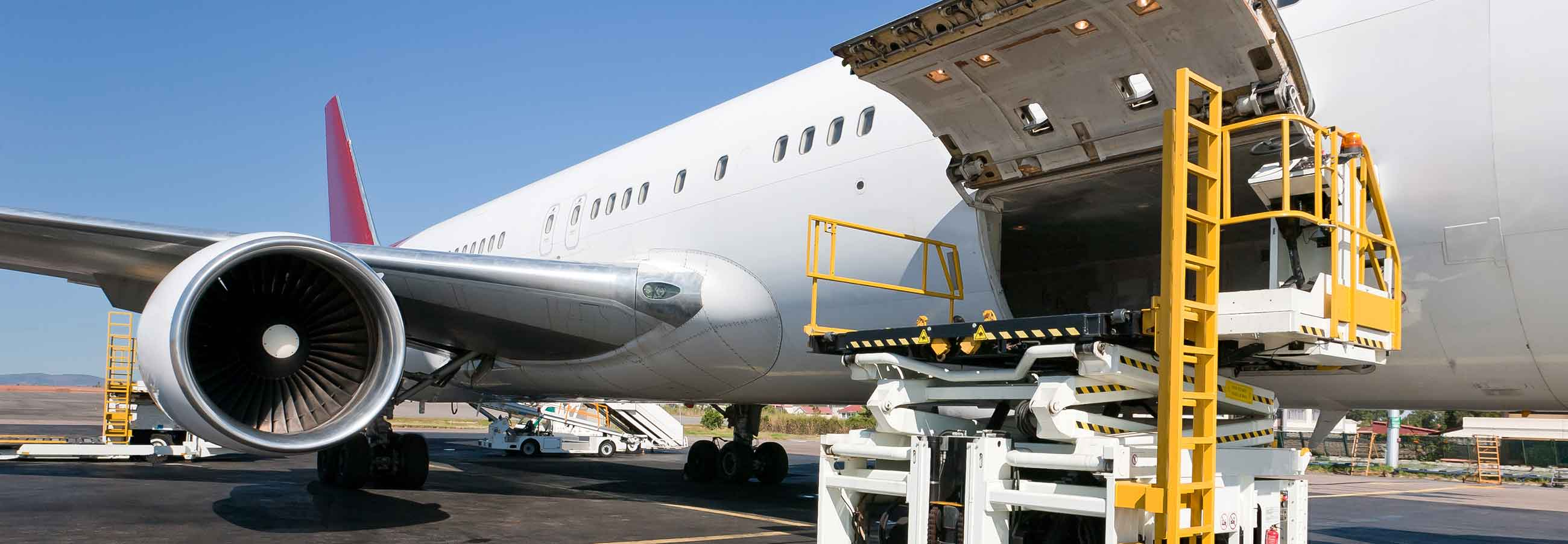 cargo plane being loaded with air freight packages