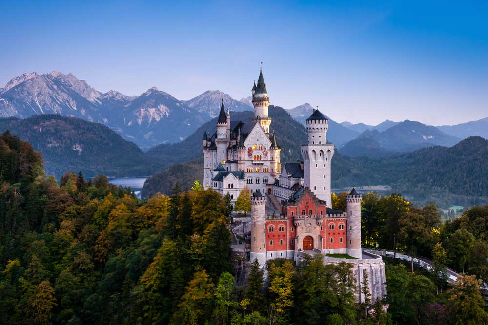 amazing shot of a castle in the mountains somewhere in germany