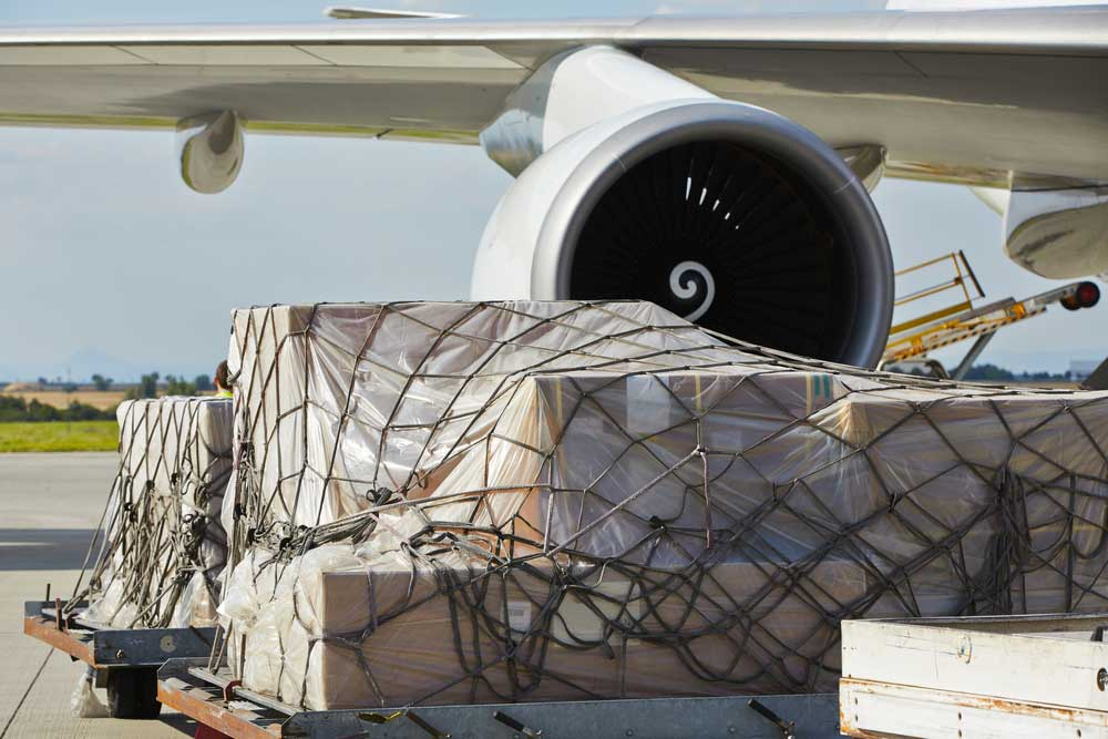 air freight ready to be loaded into the plane